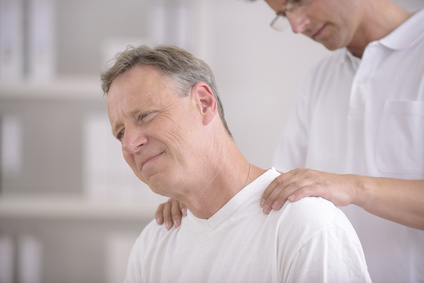 Physiotherapy: Physiotherapist massaging patient